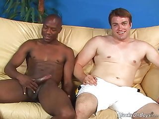 A white guy and thug sucking off each...