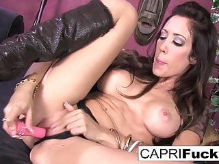 Watch as busty hottie Capri fucks her tight wet pussy