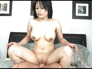 Asian milf by a ripped dude...