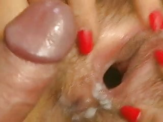close-up cumshot on hairy gaping cunt