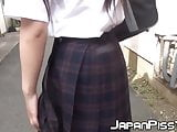 Japanese schoolgirl being naughty and peeing in public