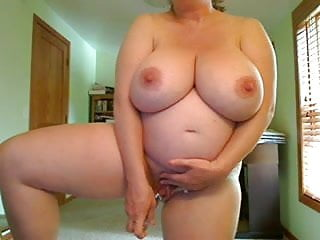 Pregnant women with big tits fucks herself standing...