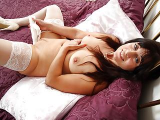 Lelani loves the feel of a big dildo...