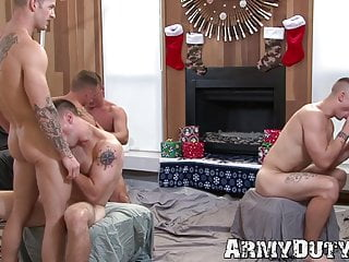 Hunky tattooed soldiers are sucking and fucking in an orgy