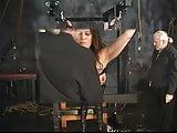 Stunning brunette bdsm victim gets her tiny tits tortured in the sex basement