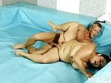 Naked BBWs wrestle in the ring