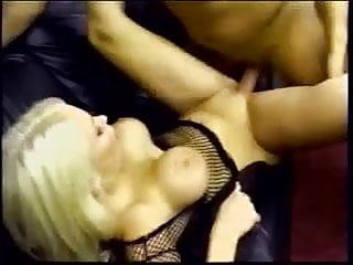 Chesty blonde slut in fishnet furiously sucks dick then fucks