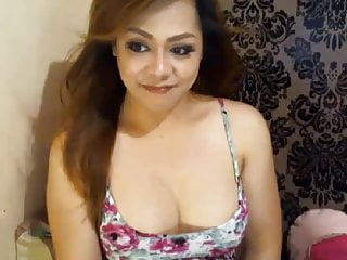 Horny asian shemale faps a flash...