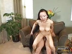Hardbody Asian milf with fake tits spreads legs on couch