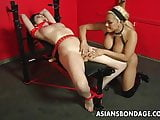 Tied up Asian slut has a finger fucking bdsm session