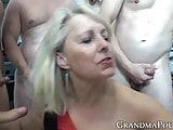Pretty granny gang banged by many hung males