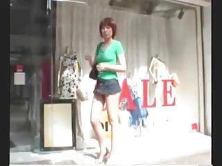 Japanese girl shopping in Tokyo in mini skirt
