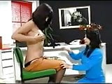 female doctor helps lactating lady