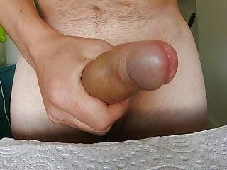 Uncut masturbation and cum, front-on view