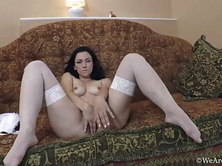 Stunning hairy Love Morris poses seductively as she strips