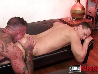 Heavily inked stud is barebacking his younger partner deep