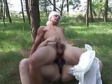 Brunette wanks partner in grass before making him come with strap-on