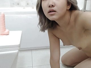 An Asian Girl Masturbates In The Shower