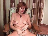 Mature redhead Liddy gets finger fucked by photographer