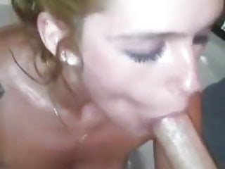 Blonde girl in bathtub mouth...