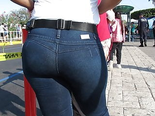 Thick luscious ass Latina in tight jeans and high heel