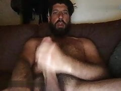Hairy chest big beard daddy stroking off his huge cock